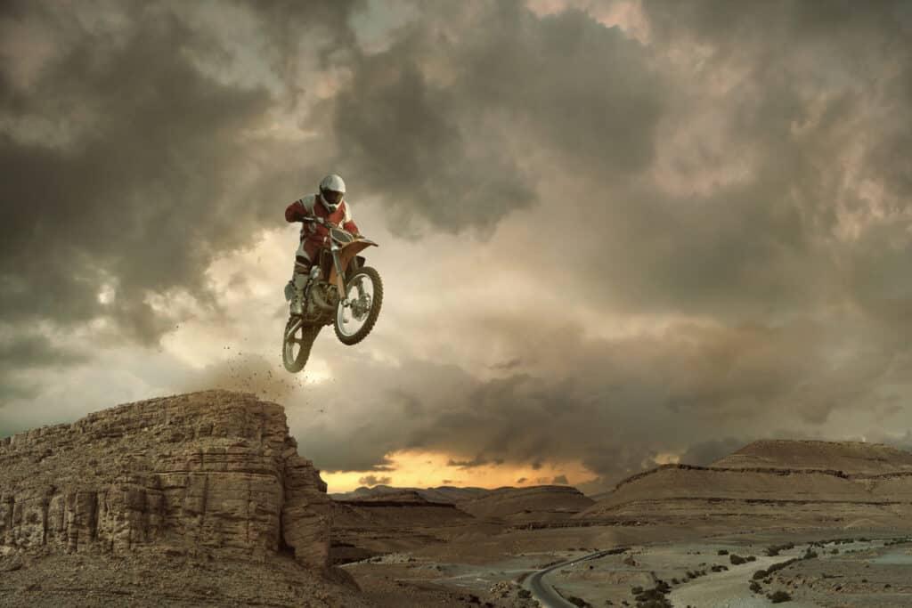 Dirt bike jumping in the desert.